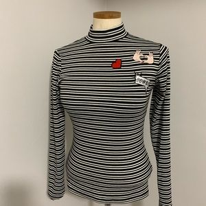 Romeo and Juliet couture striped turtleneck